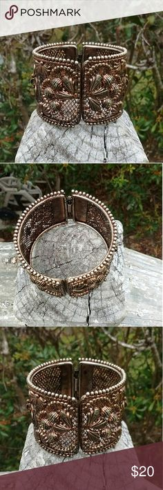 Statement Vintage Style Mesh Bracelet *metal mesh bracelet with decorative floral design  *This is a hinge type bracelet  *Bracelet has wear because of age, but still a good piece if jewelry  *Pre-loved Jewelry Bracelets