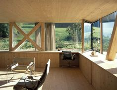Love this hunkered-down woodland home. Beautiful place to work.  House in Balsthal by Pascal Flammer | Yellowtrace