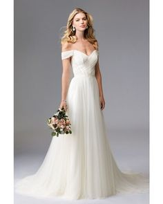 Asymmetrically ruched netting overlays the off-the-shoulder lace bodice with V-neckline and exposed piped boning of this WTOO 17757 Heaton wedding dress. This gown has a V-back and the waistline is cinched with a Grosgrain ribbon band. The A-line skirt with sweep train flows in layers of soft netting.