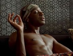 Lafayette's reflective patterned wallpaper from True Blood. Now THAT is an accent wall!  (Also a transparent excuse to look at Lala. Hi.)