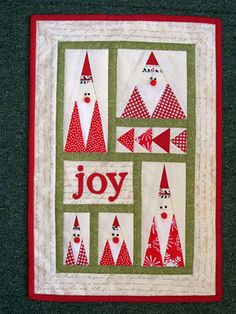 great patchwork Santa wallhanging. I LOVE THIS.  I think it's a must try....although probably not this year!