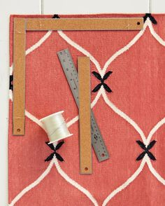 Is your rug tripping you up? Keep cotton flat-weave and other lightweight rugs from slipping around and curling with this tried-and-true trick: Attach a pair of flat, cork-backed rulers along the edges of each corner.