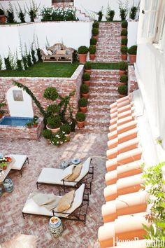 You can never go wrong with topiaries. In Mark D. Sikes's Los Angeles house, the tiered garden gets an extra dose of greenery thanks to rows of them.   - HouseBeautiful.com