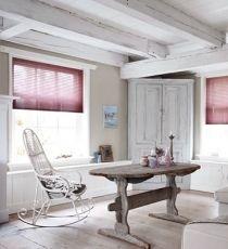 Een warm kleuraccent voor de ramen.