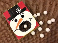 """Summer barbecues have bean bag toss (or cornhole, as some folks call it), and winter get-togethers now have """"hungry snowman."""" Learn how to make your own at Cul de Sac Cool.   - WomansDay.com"""