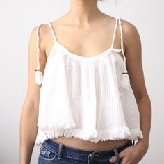 Free People Top Gorgeous top from free people. Adjustable straps that tie together and had tassels and bells on the ends. Fringe all along the bottom. Top was just tried on for photos.    » Offers through the offer button  » Bundling discounts available  » No trades » NWOT Free People Tops Tank Tops