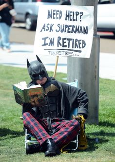 What would Batman do after retirement? Obvi read Harry Potter in his PJs.    Click for more awesome photos from Comic-Con 2012. (Photo: Frazer Harrison, Getty Images)