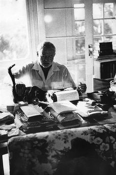 Ernest Hemingway with cat at his home in Cuba, the Finca Vigia, 1954