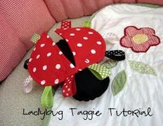 Lady Bug Taggie Toy for Babies.............Materials:  free printed pattern (right click, save as, should save in the correct size, print!)    felt for back of wings  felt for body  fabric for front of wings  various ribbons and trims  embroidery floss - black and red  thread to match wings  fiberfill  two small bells (will be sewn inside wings)
