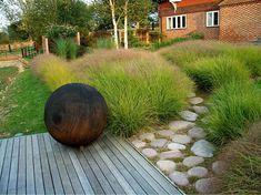 .stipa arundinacea, hardscaping, ornamental grasses, landscaping, landscape design