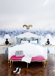 Crisp bedroom with white, blue and a pop of pink in the upholstered bench - Spazzio Rosso