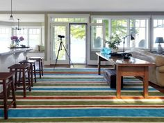 Paint an inexpensive carpet remnant  with Simply Spray Upholstery paint to create this gorgeous area rug from DIYNetwork.com