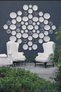 Viceroy hotel: an elegant combination of white wingback chairs, blue walls and decorative plates.