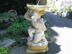 This cool antique sculpture can also be used as a planter!