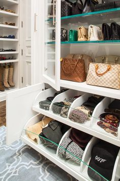 Bags, boots, hats and scarves: Every item has its place in this glamorous custom closet. Pullout drawers for accessories and glass-fronted cabinet doors keep items on display and easy to reach.