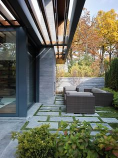 Ground cover btween cement pavers for patio and/or driveway.Toronto Residence by Belzberg Architects