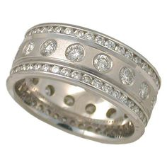 Two carats of diamonds set in eternity band of 14K white gold.