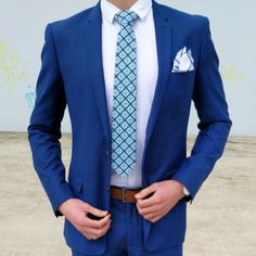 Bright blue suit paired with a Mexican tile tie in blue and turquoise.