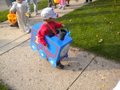 Halloween Thomas Costume  Carboard, Paint, Glue gun, empty ribbon roll or tube from plumbing section at hardware store.