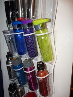 Water Bottle Storage.  Finally a solution for  bottles and travel mugs! Genius!  They take out so much cupboard space!