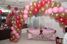 Balloon arch designed by Kouture Designs Kreating Smiles for a baby shower.