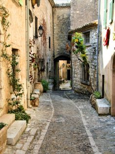 Ancient village of St. Paul de Vence- France -----The  history, the art made by the people who lived there, the little old men playing boules or(petanque) under the trees.