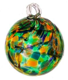 Witch Ball - Legend has it that evil is attracted to these colorful balls, pulled inside, and then trapped within the glass webbing, thus protecting the home from harm.