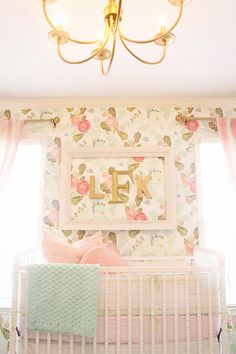 Pink and mint Anthropologie wallpaper and good monogram in Landry Kate's Vintage Glam Nursery
