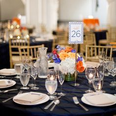 Small orange, white and blue flowers popped against the navy blue table linens.
