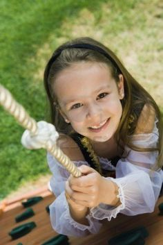 12592724-dressed-up-little-girl-climbing-a-rope.jpg 801×1,200 pixels