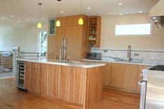 Great use of Zebra Wood to highlight the island!