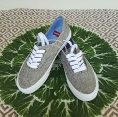 Levi's Women's Sneaker Levi's brown/grey tweed like canvas sneaker. Brand new! Never used! I believe they run a bit big. Label says 5.5, I'm usually a 6 to 6.5and I fit into these just fine. Levi's Shoes Athletic Shoes