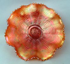 marigold carnival glass; my grandmother had a whole buffet full of these in assort'd colors.