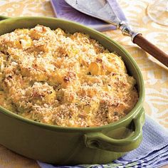 Two-Cheese Squash Casserole | Cheddar and Parmesan combine forces with yellow squash in this creamy casserole. For a tasty and colorful twist, substitute sliced zucchini for half of the yellow squash. | SouthernLiving.com