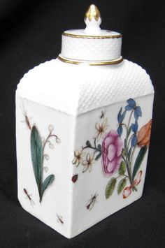 Meissen tea caddy and cover circa 1740-45 , with o Ref: Q985  Meissen tea caddy and cover circa 1740-45 , with ozier moulded borders, finely painted in the manner of J.G. Klinger with a bundle of cut flowers tied by a ribbon and scattered iinsects, crossed swords marks in underglaze blue