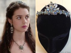 """In the episodes 1x09 (""""For King and Country"""") and 3x04 (""""The Price"""", pictured) Queen Mary wears the Paris by Debra Moreland""""Alice Blue Gown"""" Tiara.You can email at info@parisstyles.com for purchasing information.In the episode 1x09 she wears it with the Oscar de la Renta top, Reign Costumes custom skirtand Roberto Cavalli belt. In the episode 3x04 Queen Mary wears the tiara with the Reign Costumes custom gown, Gillian Steinhardt labyrinth and signet rings."""