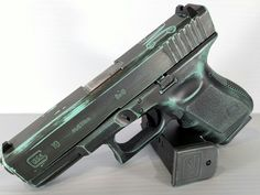 Battleworn look on this Glock using Robins Egg Blue (similar to Tiffany blue) and Sniper Grey.  The monogram was used to add a little more customization.