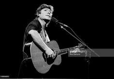 Singer/Songwriter John Denver performs at Chastain Park Amphitheater in Atlanta G eorgia August 24, 1991.