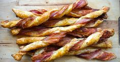 Puff pastry spread with Dijon and sprinkled with Parmesan, then twisted with streaky bacon, is baked till it's crispy, puffed and golden. A divine savory snack!