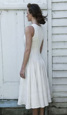 Agnes    $3195.00    Hand-stitched, 100% organic cotton jersey, pull on dress has fitted bodice and full skirt with delicate embroidered details. Each piece custom made to your specifications. Wash Gently + Hang to Dry. Made in the USA.