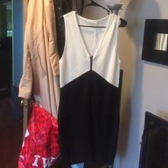 Trina by Trina Turk Black & White dress Ribbed sweater material body con type dress. zipper down the front. Never been worn and tags attached. Trina Turk Dresses Midi
