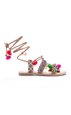 Pom Pom from Shop Spring Shoes Under $100  Chinese Laundry Posh Beaded Flat Sandal Leg-Tie Pom Sandal, $80