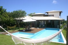 Maravilhosa casa com 05 suítes em condomínio de alto padrão em Itacimirim, Bahia, Brasil.  Saber mais aqui - http://www.imoveisbrasilbahia.com.br/itacimirim-casa-em-condominio-de-luxo-a-venda