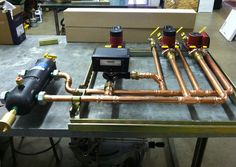 Radiant Engineering Inc, specialists in hydronic radiant heating systems - work in progress on the bench in our shop.