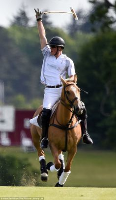 He scores: Prince Harry looked in good spirits as he galloped across the pitch, punching the air when he scored