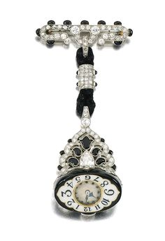 ENAMEL AND DIAMOND WATCH, AGASSIS, CIRCA 1925.  The circular dial applied with blued steel hands and Arabic numerals, suspended from a mount set with millegrain-set black enamel, circular-, single-cut, pear-shaped, and rose diamonds, French assay marks, indistinct maker's marks, movement signed Agassis.
