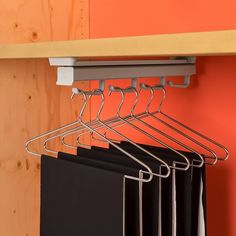Particularly suited to deep, narrow spaces, the Ambos Pull Out Hanger Rack extends out to assist with finding the item you want, and is top mounted so it can be installed under shelves.