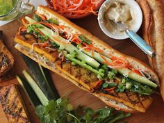Crispy tofu is marinated in garlic, coriander root, and lemongrass, and stuffed into a Vietnamese-style sandwich with pickled carrots, daikon, cilantro, cucumber, and jalapeños. The trick is a low and slow cooking method and a double coating of the flavorful marinade. #vegan