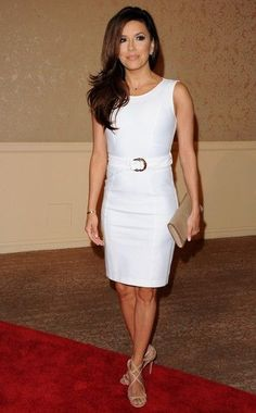 She wore a Gucci white belted dress.