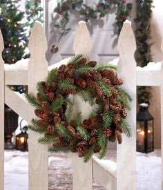 This is a pine cone and berry wreath that can be used for decorating your front door or out on your cover porch. This is one you can use now for Christmas and all the winter.